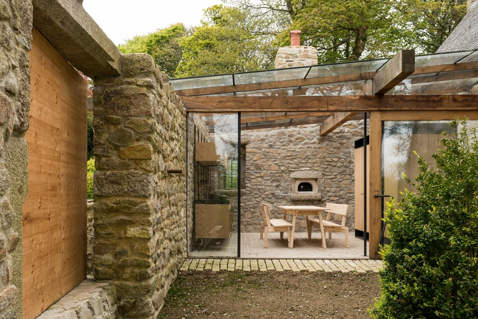 Outdoor and Gardens The kitchen, the property's only modern addition, has been created from a garden courtyard. The space has been enclosed by a glazed roof and wall with sliding door, yet it retains its open feel.  Best Photos from A Revamped Estate in the English Countryside Asks $2.3M