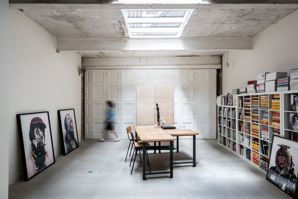 A vast, well-lit single space,  the owner uses the ground-floor room as a studio/workspace, but it could be used for other purposes.  The room can be divided in two using full-height bi-fold doors that sweep across the polished concrete floor as this photograph shows