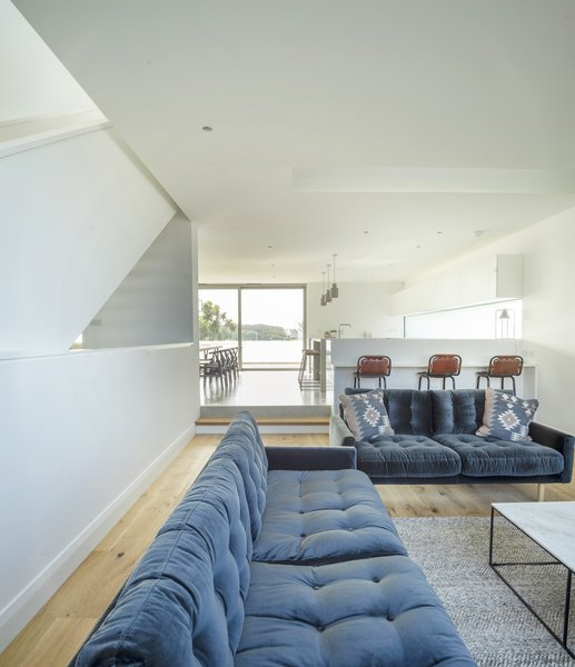 Although this living space is open to the open-plan kitchen/dining area, the change in levels between the two rooms makes it feel like two separate spaces.