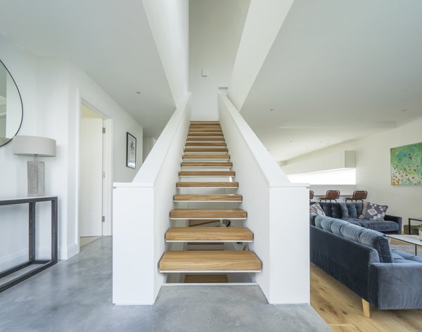 The Open Hallway And Staircase Increase The Flow Of Light And Feeling Of  Airiness.