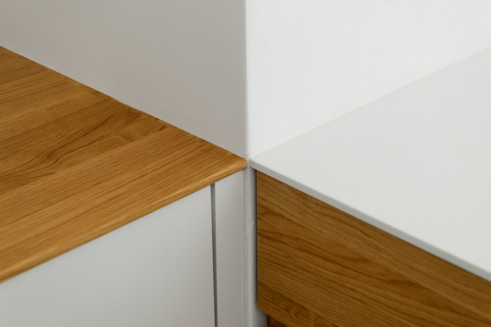 The Kitchen Detail: Natural oak and white quartz stone were designed as only 1 cm thick for a clean and refined finish