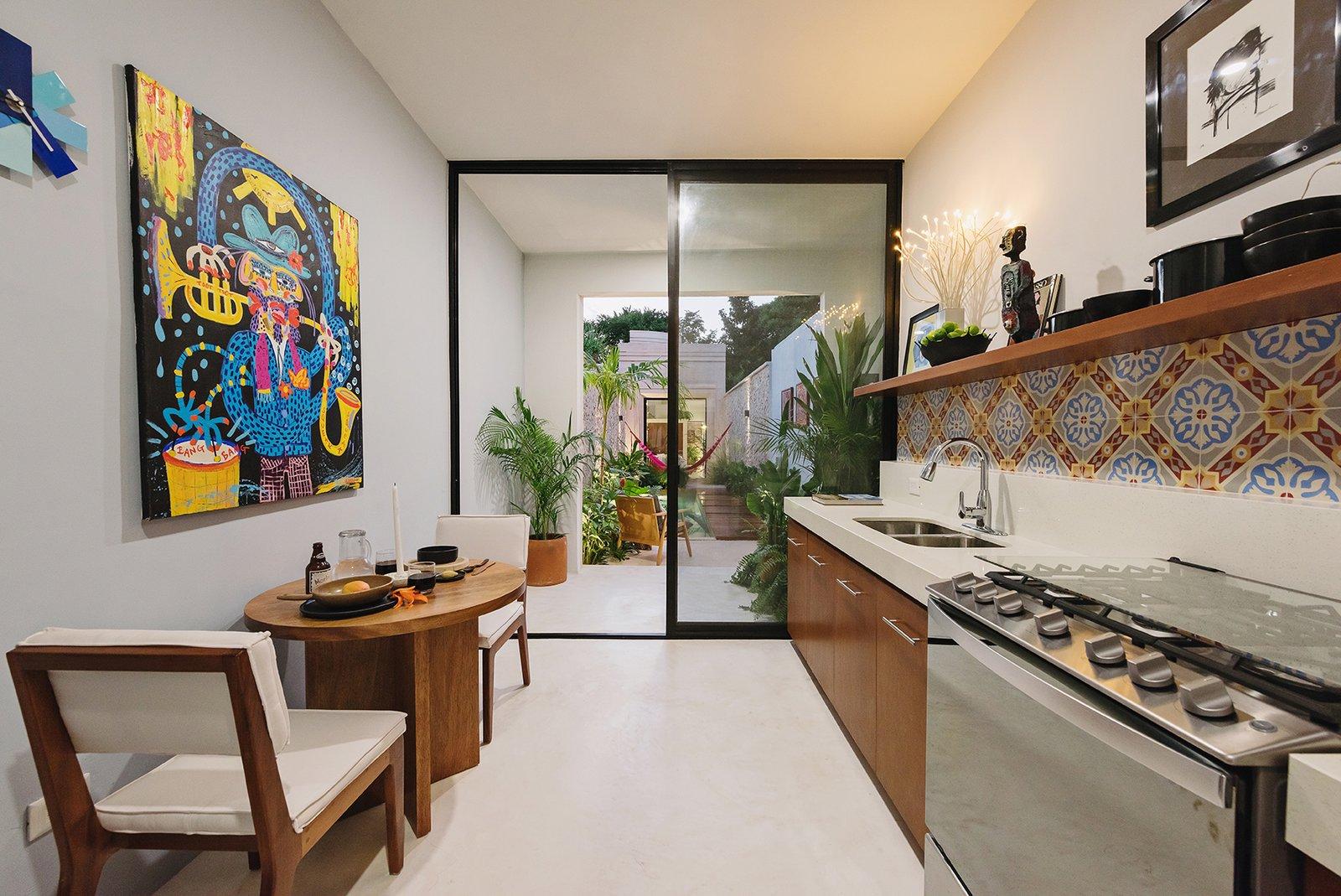 Kitchen, Refrigerator, Wood, Engineered Quartz, Mosaic Tile, and Concrete Kitchen  Kitchen Wood Mosaic Tile Photos from Casa Picasso