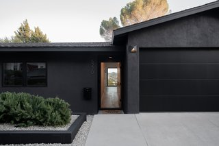 Clean lines and a sleek black exterior welcome you to this North Highland Park hilltop home.