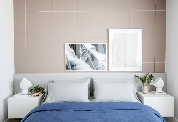 UPGRADE YOUR BED: A king size MALM bed is hacked by using infill panels to extend the headboard wall to wall. The headboard is wrapped with foam and finished in a soft grey wool felt. Wall mounted BESTA units frame the bed and serve as night tables.