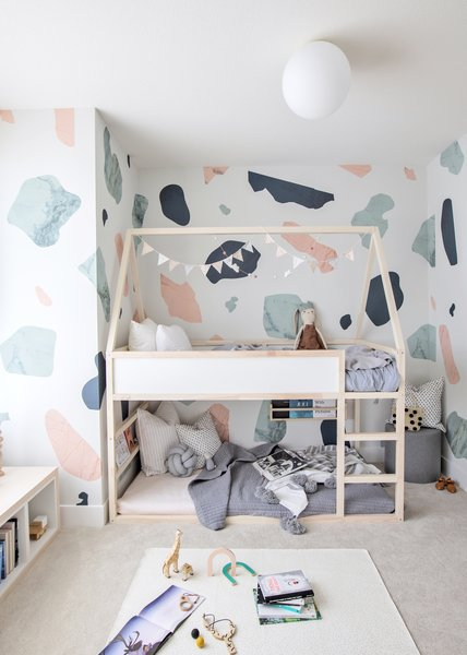 REIMAGINED TODDLERS BED: Reimagine the KURA bed by adding a roofline and white washing the bedframe. This simple structure transforms into endless possibilities for a child's imagination.