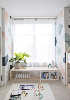 DIY WINDOW SEAT: Under a windowsill, EKET cubes are used to create a structure and storage for a DIY window seat.