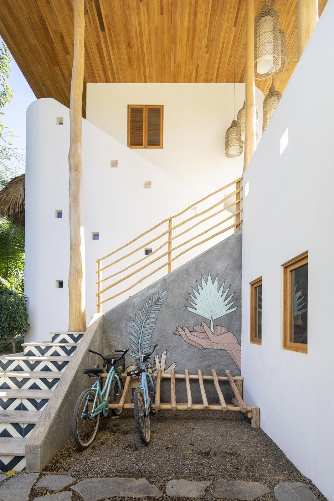 Beach House Building Type, Metal Roof Material, Concrete Siding Material, and Flat RoofLine Bike rack   Nomadic Nosara