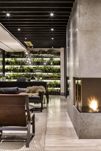 A vertical garden decorates the far end of the dining room.