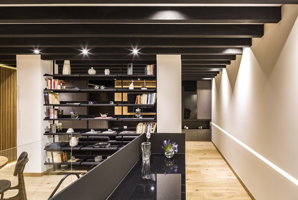 A steel bookcase designed by the firm divides the space