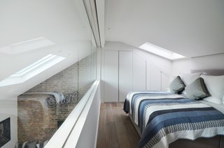 The Master bedroom ensuite faces through a large internal glazing the living areas below