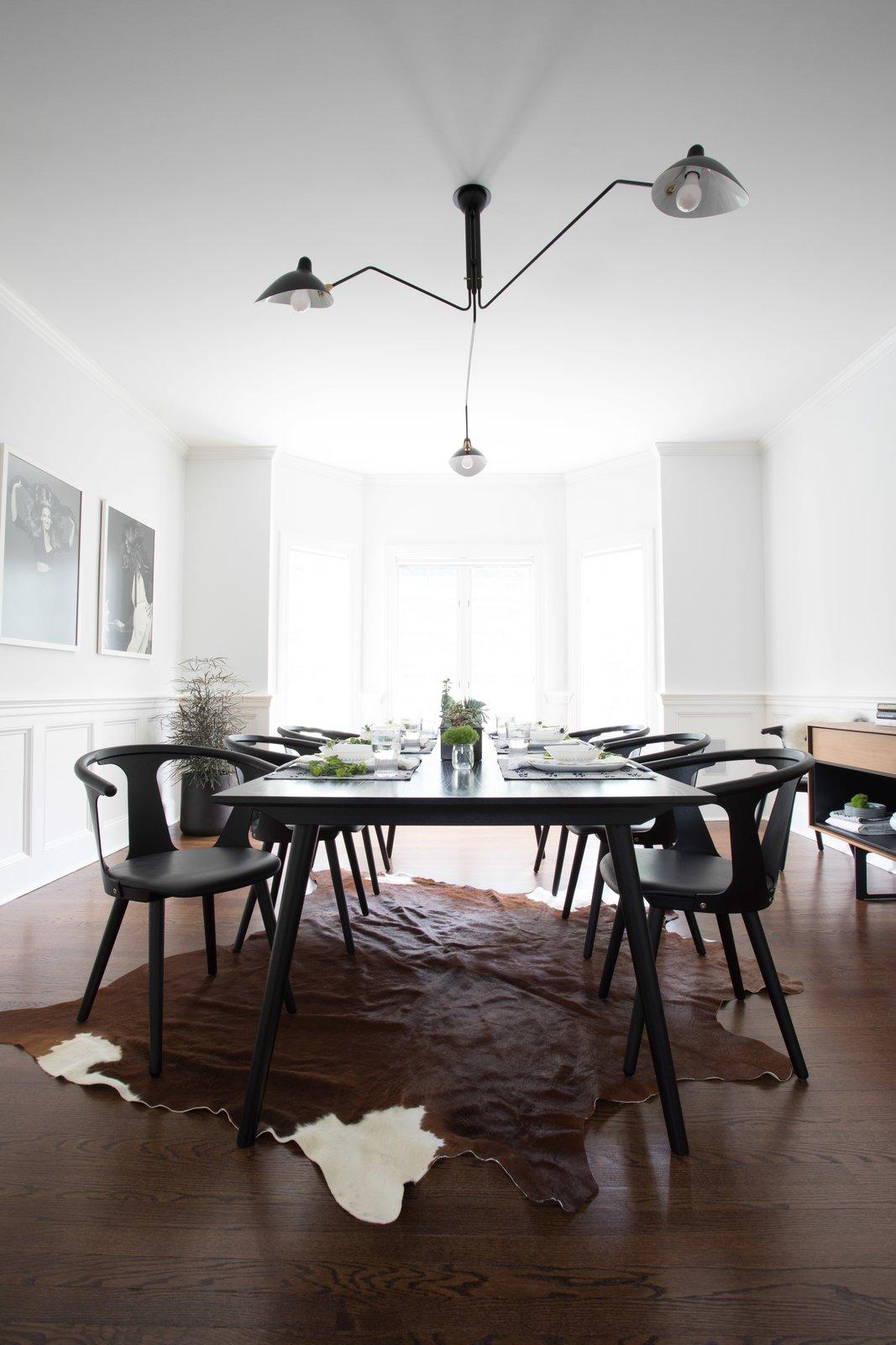 Dining, Ceiling, Dark Hardwood, Chair, and Table Formal Dining room   Best Dining Dark Hardwood Ceiling Photos