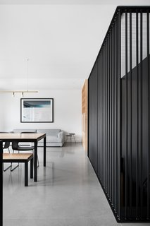 The living room couch is from Élément de base. Radiant heating is built into the polished concrete floors (Atelier B).