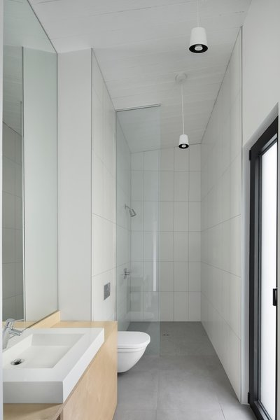 The Bathroom Features Clean Modern Finishes