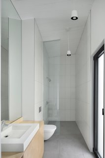 The bathroom features clean, modern finishes.