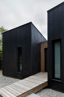 The home's charred timber exterior resembles a crow's plumage.