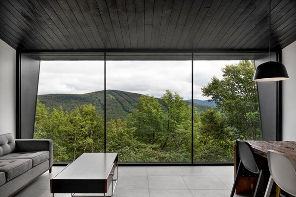 The living room provides sweeping views of mountain vistas.