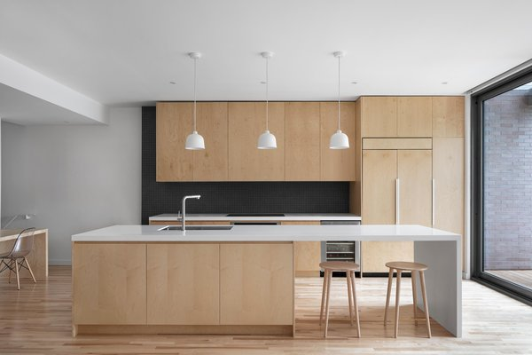 Naturehumaine Used Maple Plywood And White Accents Throughout Des Érables Residence Striking Contrast With The