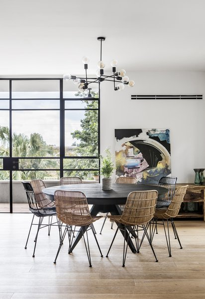 Wood floor and the Industrial metal open glass home facade bring light and balance to the space connecting the interior with the exterior landscape of South Pasadena / Highland Park
