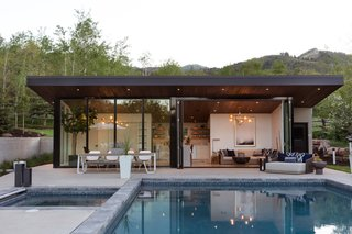 Modern pool house exterior. Designed by JBellessa Design. Indoor-outdoor living