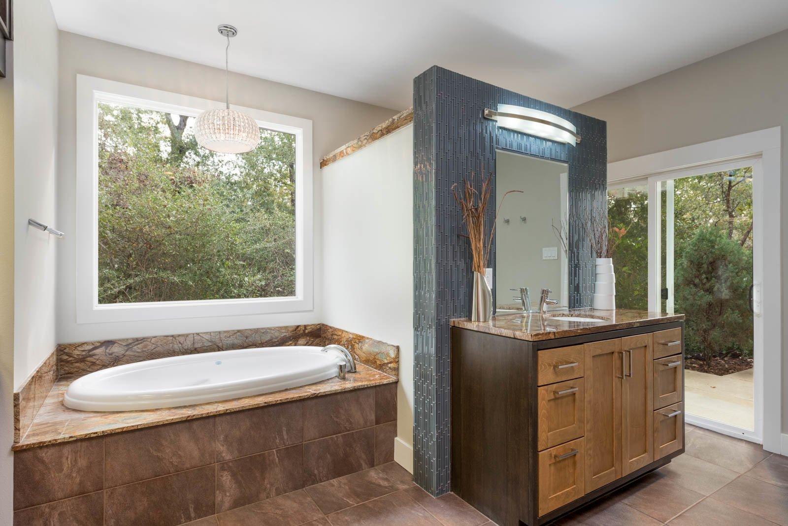Bath Room, Granite Counter, Open Shower, and Porcelain Tile Floor Master Bath  The Carlson House