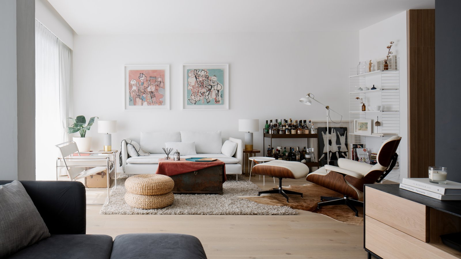 Living Room, Sofa, End Tables, Recliner, Coffee Tables, Ottomans, Bookcase, Light Hardwood Floor, Console Tables, and Chair Leaving behind the Lounge, one re-enters the Living lined with white walls. Beyond the Black Wall is the Dining.  Best Photos from Project #11