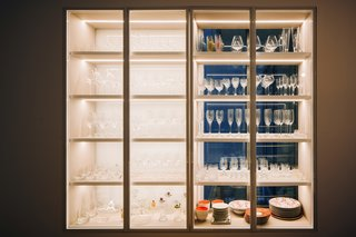 In the Dining, a display case built into an existing bay-window houses an extensive collection of wine glasses.