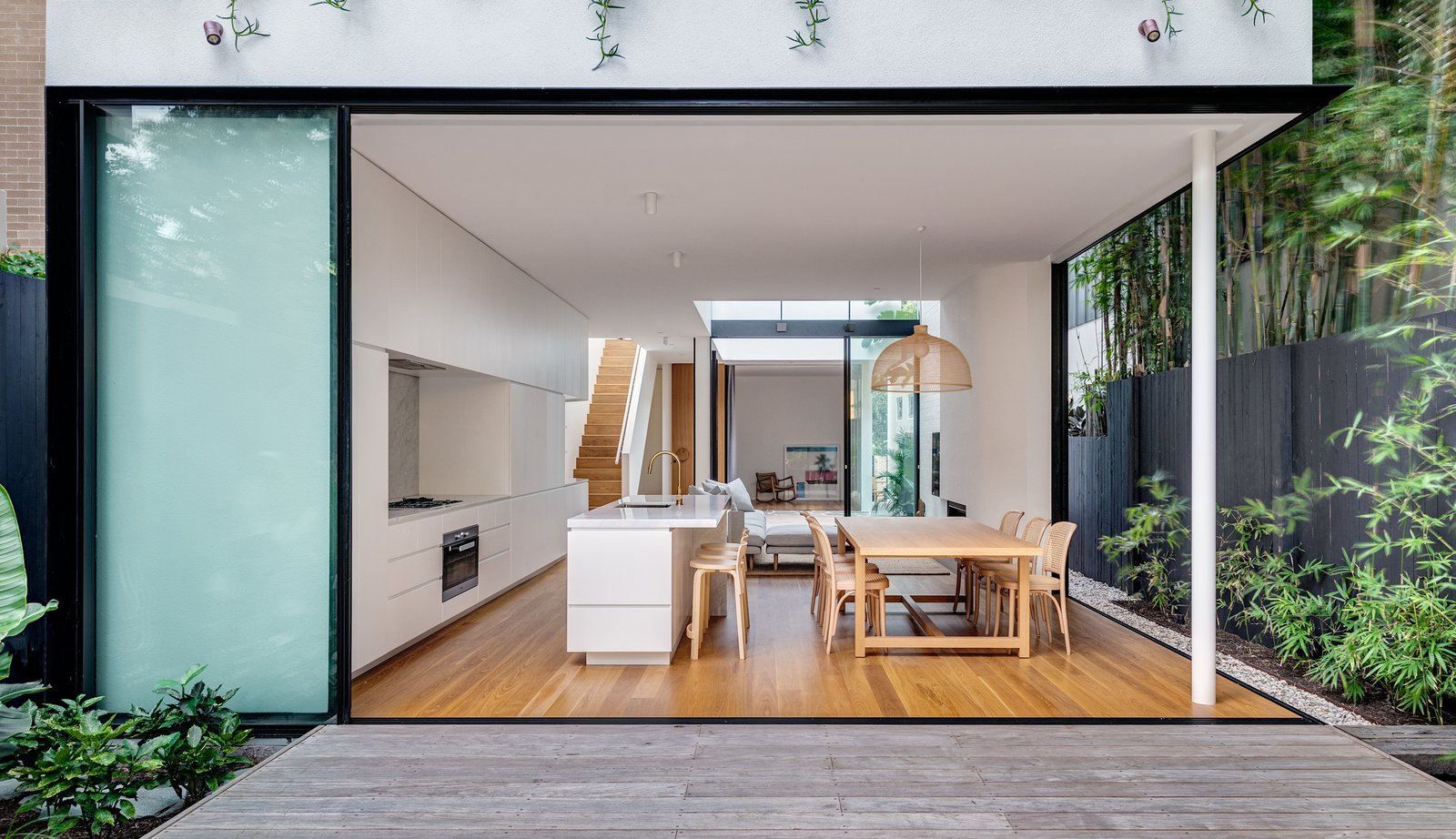 Dining, Ceiling, Pendant, Medium Hardwood, Table, and Chair The rear garden looks into the kitchen and dining space right through the internal courtyard and beyond.  Best Dining Photos from Cloud House