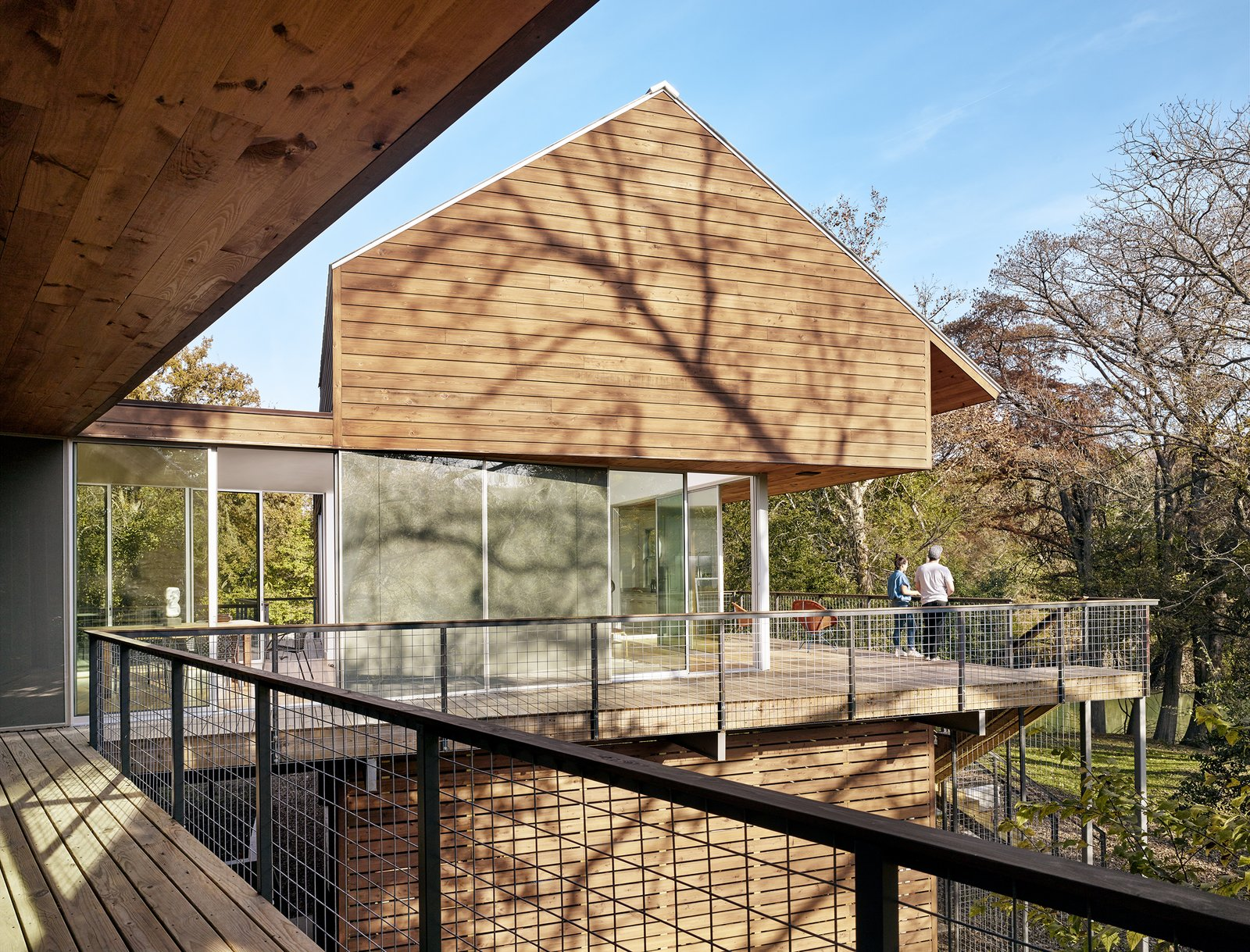 Exterior, Metal Roof Material, Wood Siding Material, Flat RoofLine, Glass Siding Material, House Building Type, and Gable RoofLine View from outdoor porch by Low Design Office  Guadalupe River House