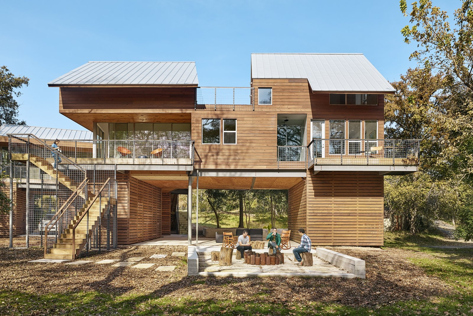 Exterior, House Building Type, Gable RoofLine, Wood Siding Material, Metal Siding Material, Flat RoofLine, Glass Siding Material, and Metal Roof Material View of house from Guadalupe River side by Low Design Office  Guadalupe River House