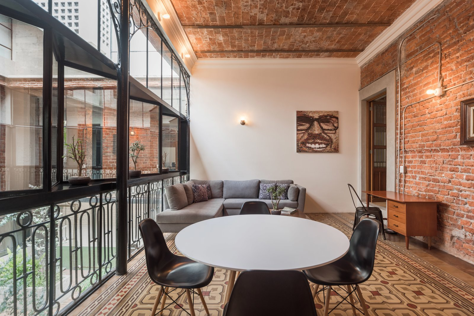 Dining Room, Chair, Ceiling Lighting, Wall Lighting, Table, Ceramic Tile Floor, and Desk Interior apartment  Lirio 7