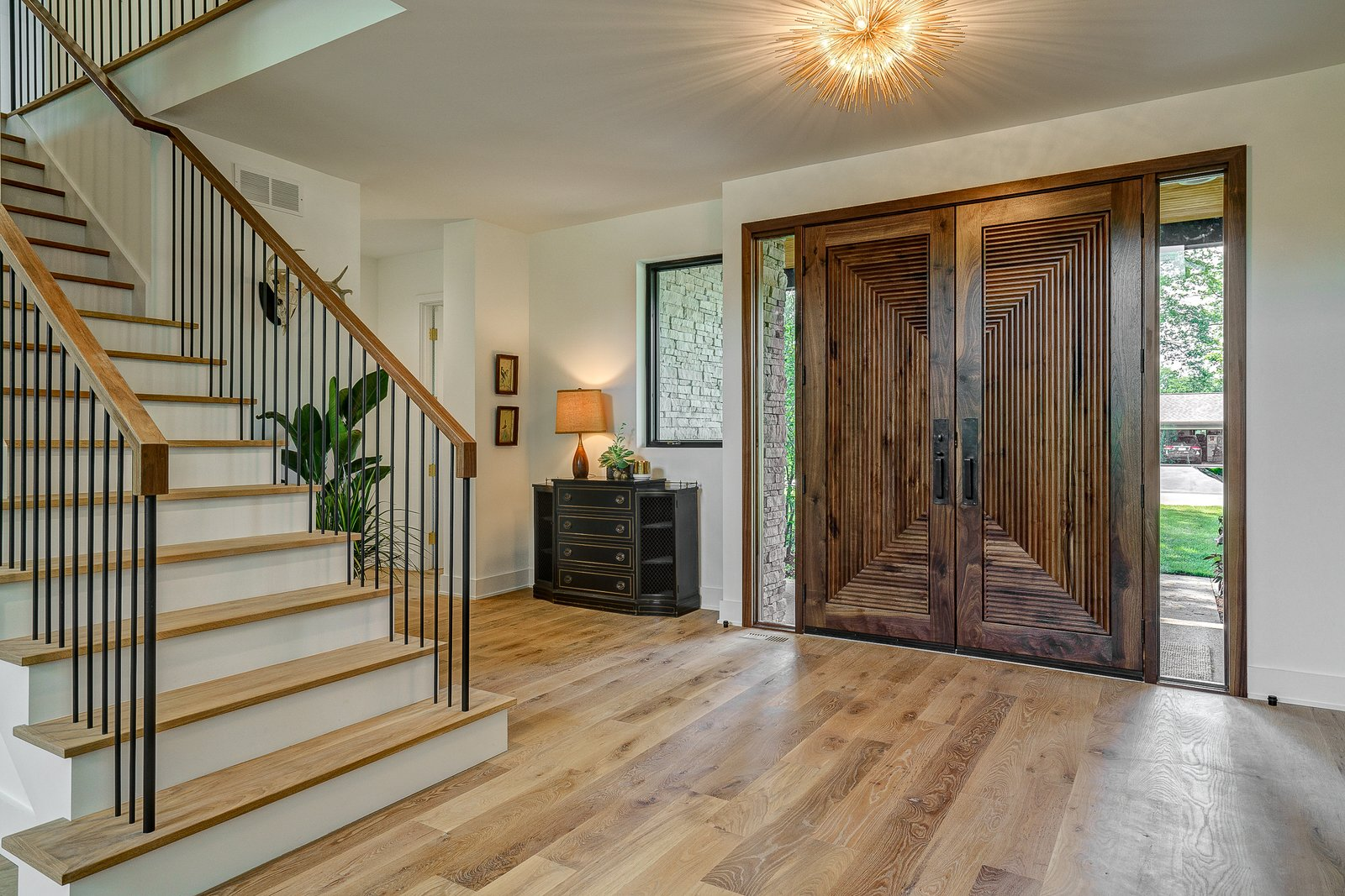 Hallway and Light Hardwood Floor Dorchester Interior Front Entry  The Dorchester Project by  Paul + Jo Studio