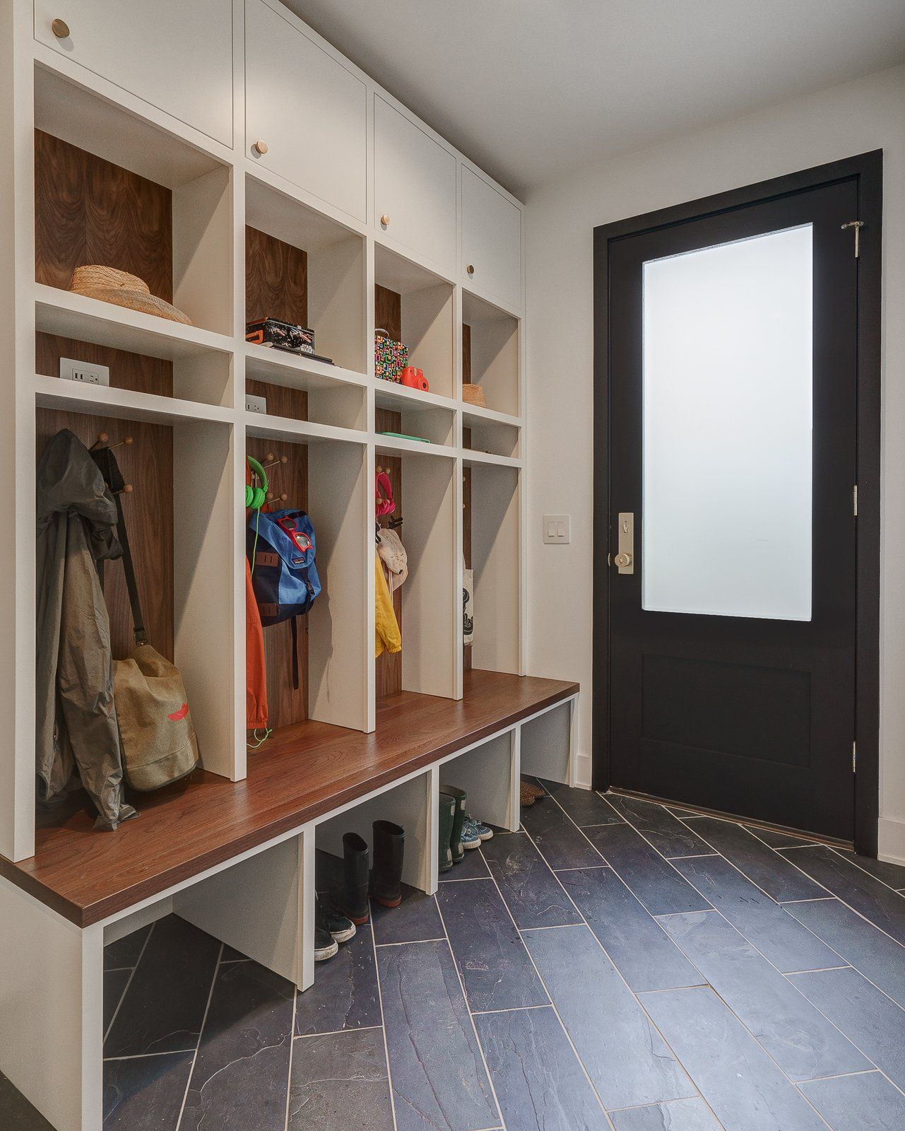 Hallway and Light Hardwood Floor Dorchester Interior Mudroom/Lockers  The Dorchester Project by  Paul + Jo Studio