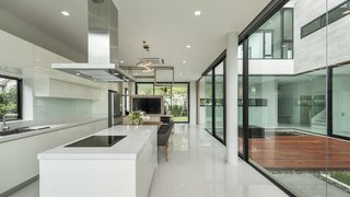 Kitchen island connecting to courtyard