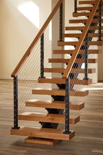 A Viewrail floating stairway with cable railing. The company believes in elevating the stairway from a functional feature to a room's focal point.