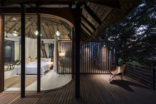 Evening shot of upper level bedroom and deck