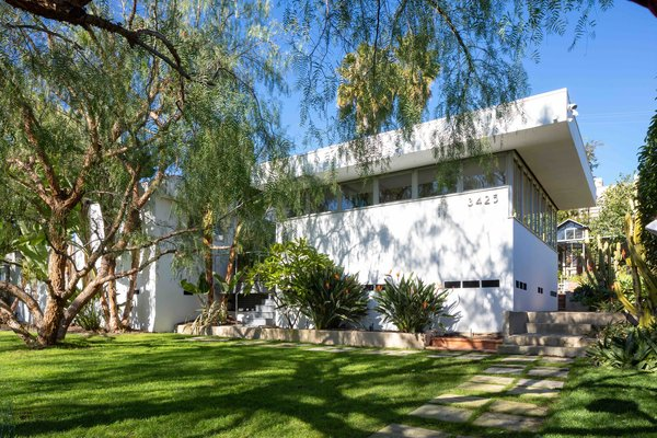 Set back from the street, the International-style home features deep, overhanging eaves and a band of clerestory windows that wraps around the entire home.
