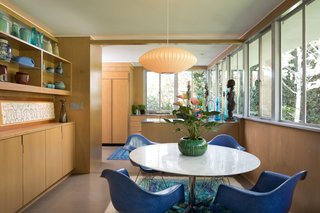 The dining room now occupies the space that was once the kitchen. The renovation opened up walls and added a credenza for serving. Originally, Lukens had requested lots of shelving for his ceramics.
