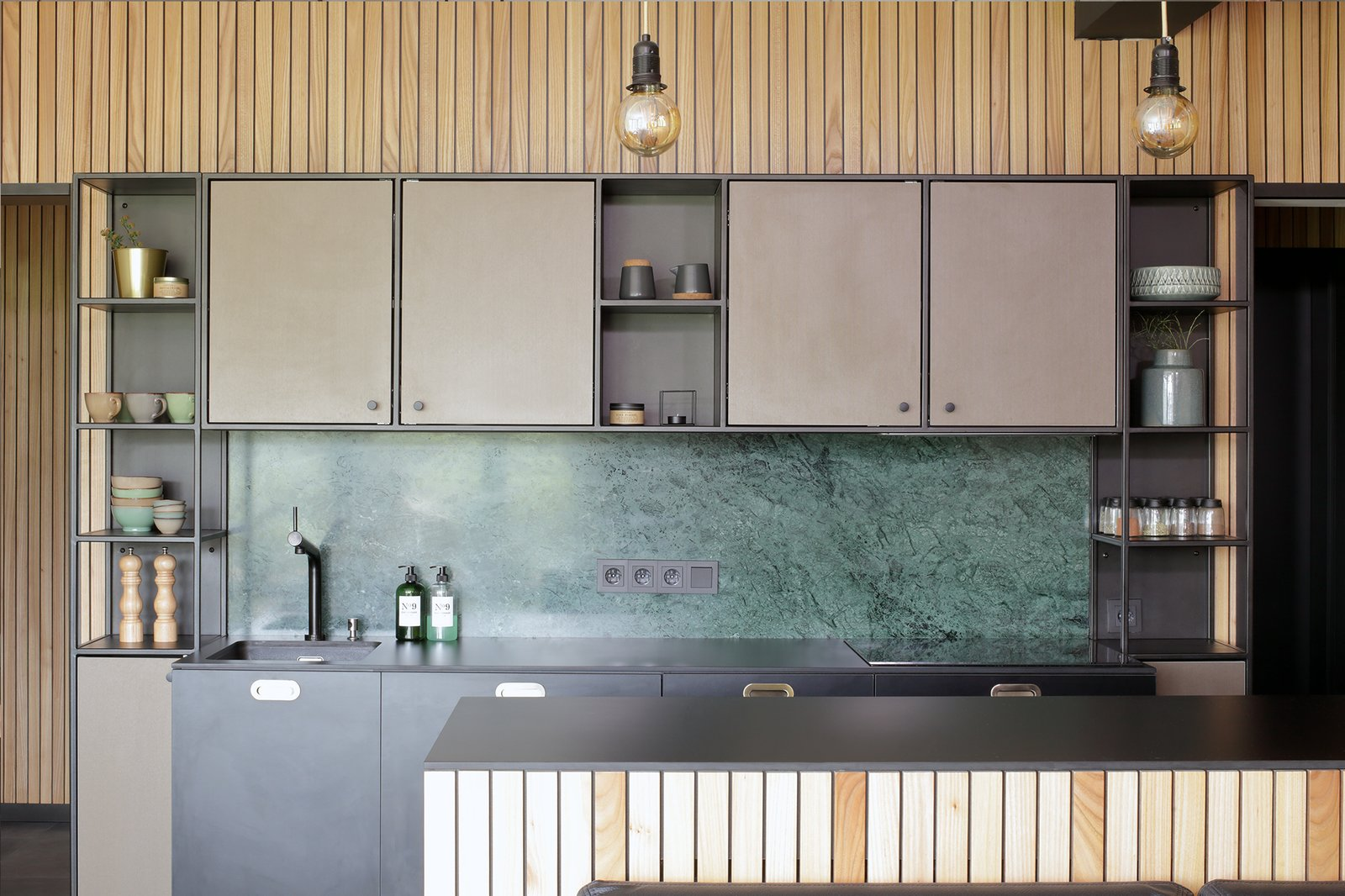 Kitchen, Metal Cabinet, Ceramic Tile Floor, Laminate Counter, and Marble Backsplashe subtle  metal construction was designed for kitchen display and cabinets , backsplash is green marble Verde Guatemala   Mountain Apartment in Ore Mountain, Czech Republic by Martina Schultes www.martinaschultes.com