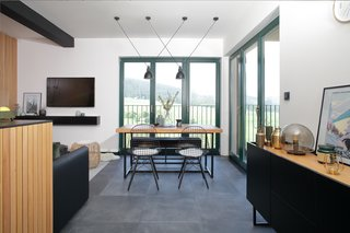 apartment offers beautiful views on mountains, dining chairs are iconic Wire chair from Vitra, design Charles and Ray Eames