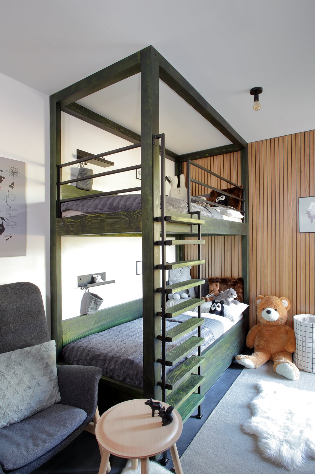 Kids Room, Bunks, Ceramic Tile Floor, Pre-Teen Age, Bed, Neutral Gender, and Bedroom Room Type bunk bed in children room - another green element in the interior  Mountain Apartment in Ore Mountain, Czech Republic by Martina Schultes www.martinaschultes.com