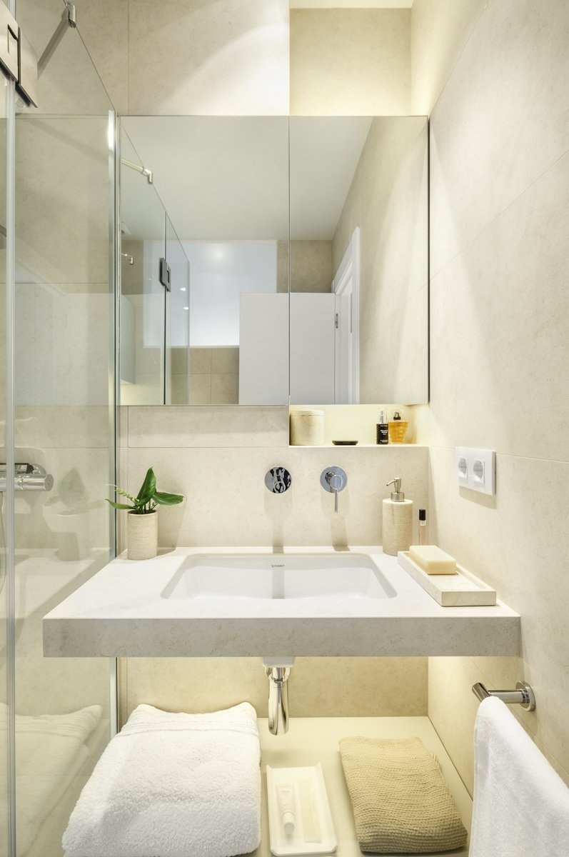 Bath, Stone Tile, Corner, Undermount, One Piece, Tile, Freestanding, Recessed, and Ceramic Tile Bathroom in a pale palette  Best Bath Corner Freestanding Recessed Tile Photos from remodelled duplex in a contemporary style