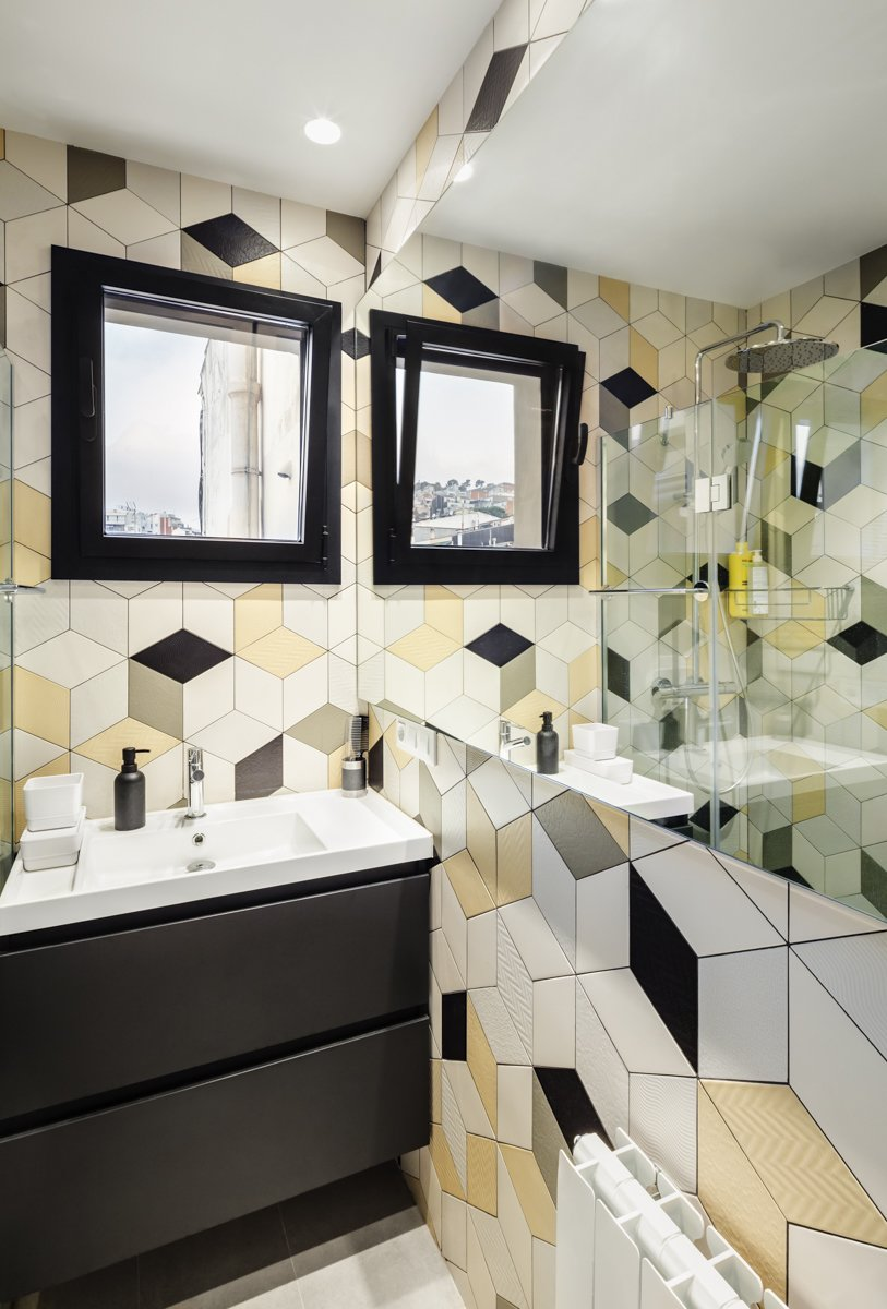 Bath Room, Engineered Quartz Counter, Ceramic Tile Wall, Ceramic Tile Floor, Recessed Lighting, Drop In Sink, Ceiling Lighting, One Piece Toilet, and Corner Shower Hexagonal tiles for a masculine bathroom  Photos from remodelled duplex in a contemporary style