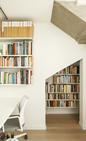 A small library under the stairs