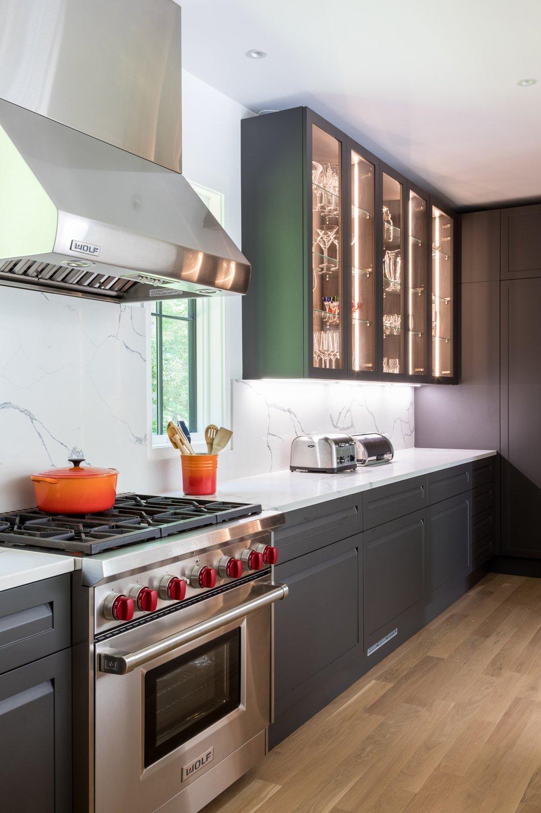 Kitchen, Drop In, Range Hood, Engineered Quartz, Range, Light Hardwood, Stone Slab, and Ceiling Kitchen 02  Best Kitchen Stone Slab Light Hardwood Photos from New Canaan Home