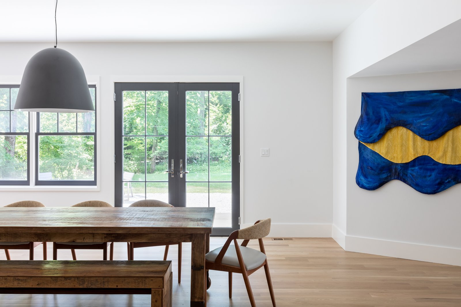 Dining Room, Table, Bench, Light Hardwood Floor, Chair, and Pendant Lighting Dining  Best Photos from New Canaan Home
