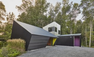 The garage, studio and Haven (outdoor porch retreat) are clustered to complete the courtyard, with accent colours providing identity and visual relief.