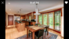 Full-size kitchen, with double-ovens, gas grills, center island, casual dining space, and adjacent large pantry.  Photo 11 of Prairie-style house on a hill modern home
