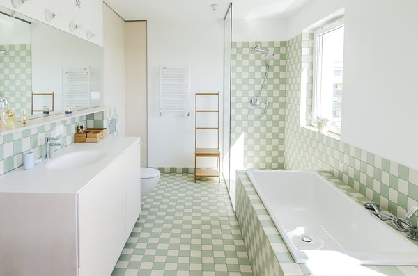 The pastel tiles used by Atelier Starzak Strebicki bring a calming mood to the washroom.