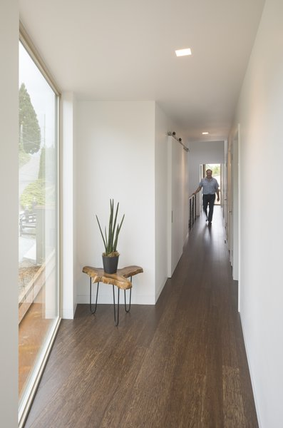 The 2nd floor corridor creates a light-filled axial connection to all 4 bedrooms and their amenities.