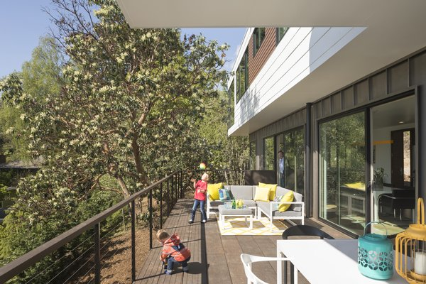 the expansive deck facing western view hunts the historic Madrona tree and is lined by floor to ceiling glass accessing the living spaces.